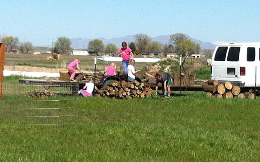 kids stacking wood